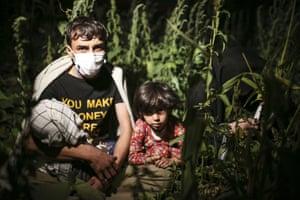 Afghan migrants sit in the countryside in eastern Turkey.