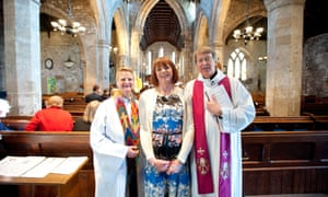 Susan Musgrove, centre, with, left, Rev Cecilia Eggleston, Paster of the Metropolitan Community Church in Newcastle-upon-Tyne and Rev David Hewlett, Vicar of Corbridge, before the start of the Affirmation service for Susan at St Andrew's Church, Corbridge, Northumberland.