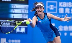 Johanna Konta of Britain hits a return against Kristyna Pliskova on the way to a three-set victory.