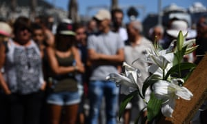 A lily, the symbol of France, is laid at the impromptu memorial to the victims of the Bastille Day truck attack.