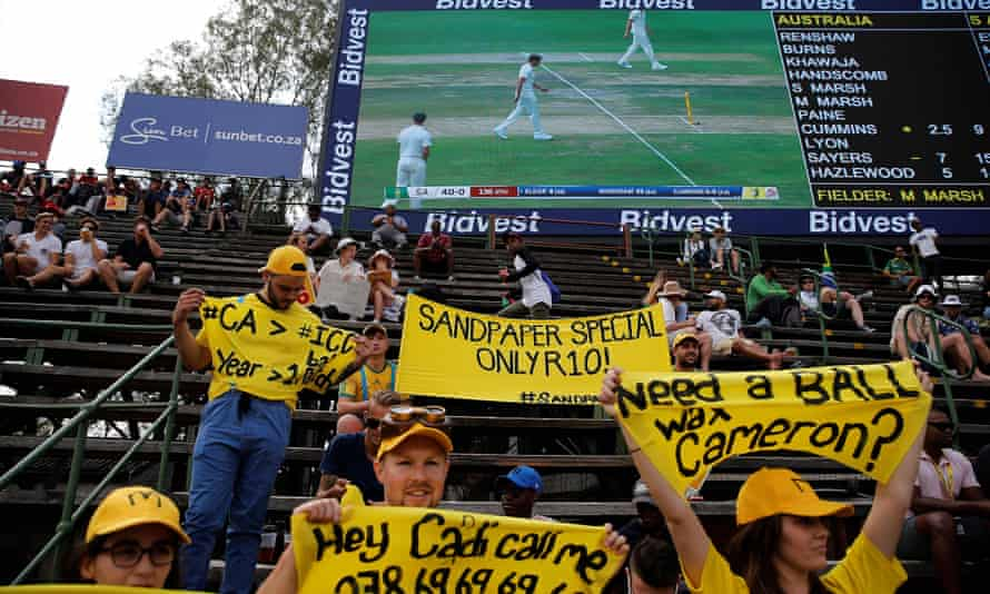 South Africa fans hold up banners taunting the Australia team on the first day of the fourth Test at the Wanderers in Johannesburg.