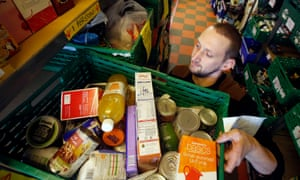 Worker at a foodbank carry produce