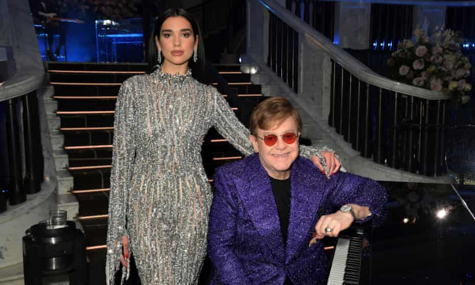 Cold Heart singers Elton John and Dua Lipa at John's annual Aids Foundation Academy Awards viewing party in April.