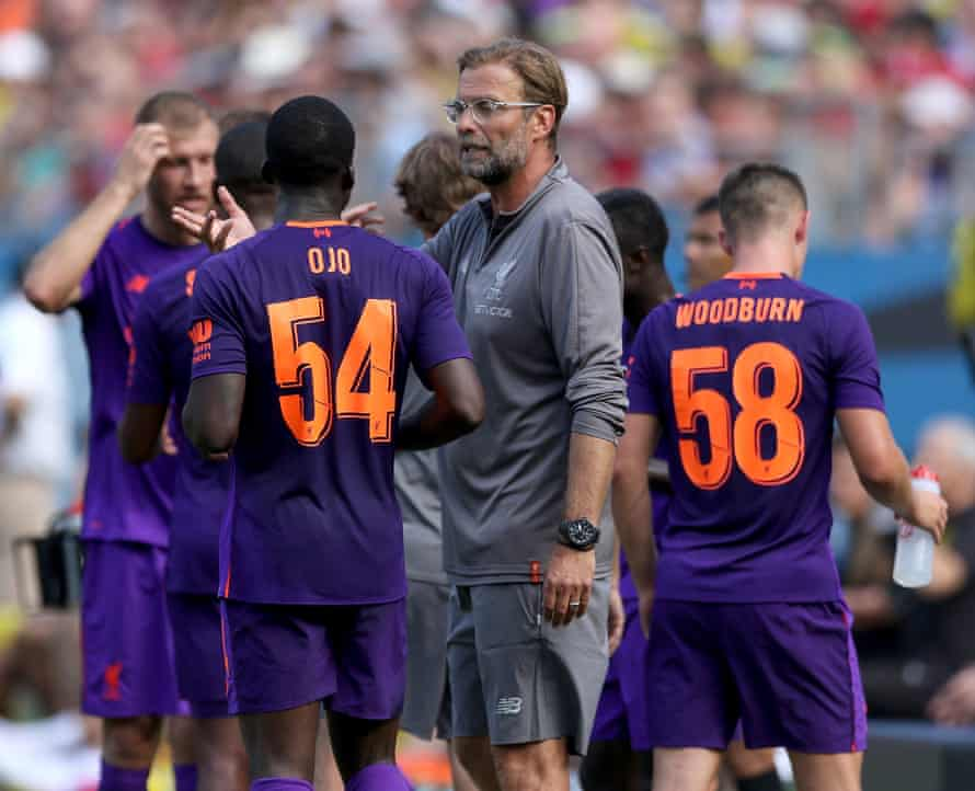 Jurgen Klopp addresses his players during a break in action against Borussia Dortmund