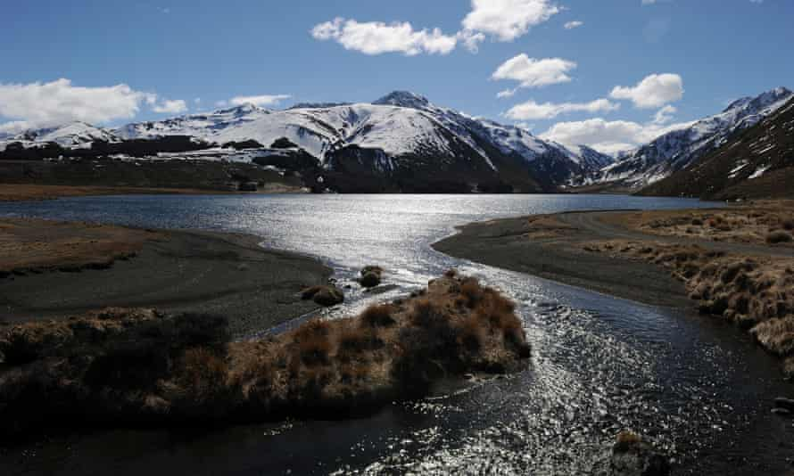 A lake, stream and snow-capped mountains near Hanmer Springs on New Zealand's South Island
