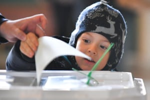 2018 Russian presidential electionMOSCOW, RUSSIA - MARCH 18, 2018: A little boy casts his parent's vote into a ballot box during the 2018 Russian presidential election at a polling station at Moscow's Kazansky railway station. Maxim Grigoryev/TASS (Photo by Maxim Grigoryev\TASS via Getty Images)