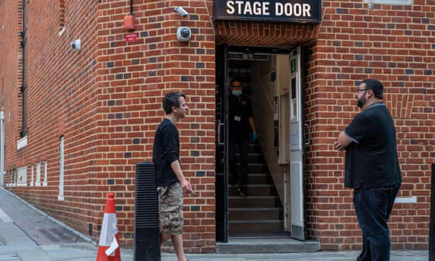 Theatre workers outside a stage door