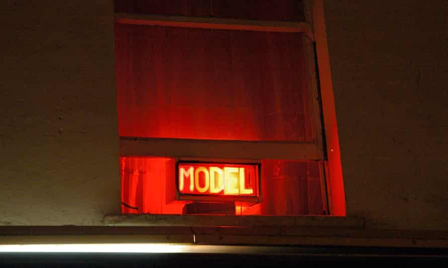 Neon sign advertising a live model or prostitute.