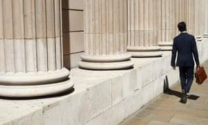 A pedestrian walks past the Bank of England