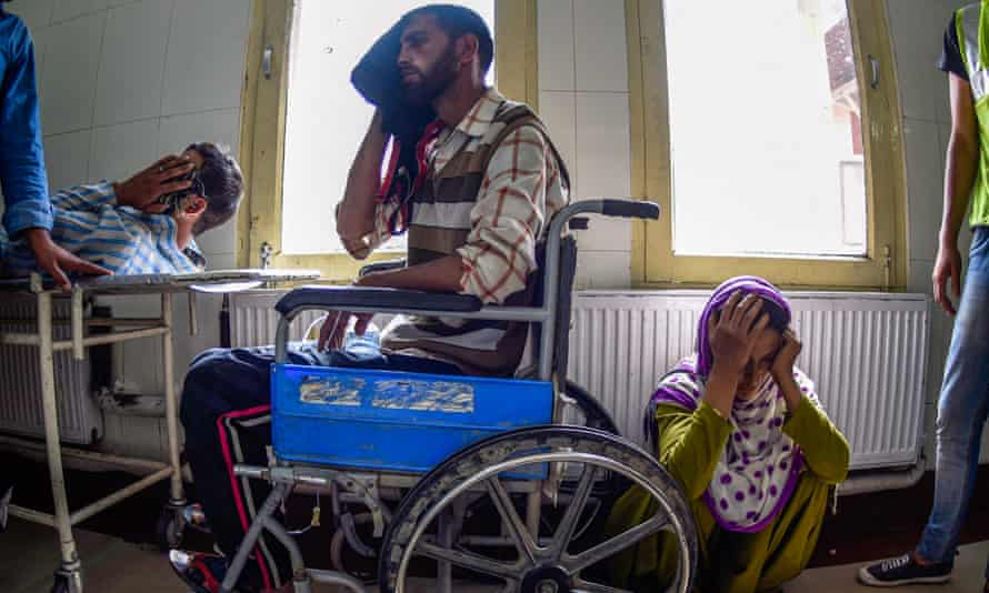 Wounded Kashmiris wait in a hospital after Indian security forces fired on them in Srinagar in 2016, when 10,000 people were injured during fierce protests over the killing of a rebel commander.