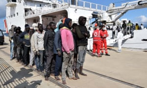 Migrants and refugees arrive in Messina, Sicily, following a rescue operation at sea by the Italian Coast Guard ship Diciotti in 2016.