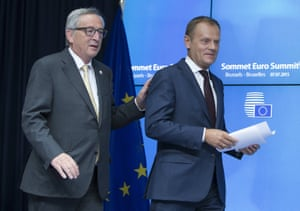 European Commission President Juncker and European Council President Tusk arrive at a news conference in Brussels.