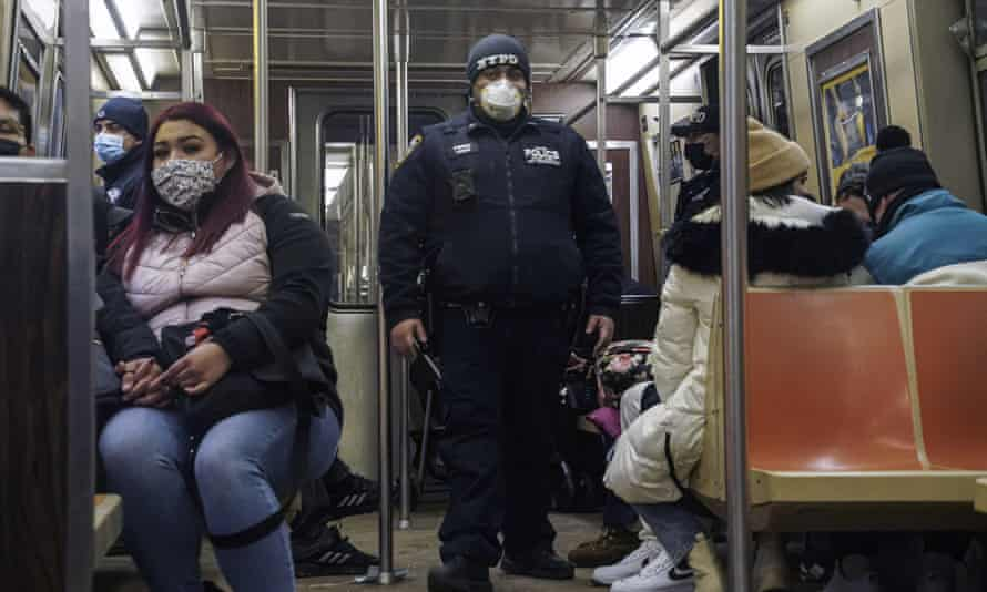 A police officer patrols New York's A line subway after a series of knife attacks left two people dead and two injured.