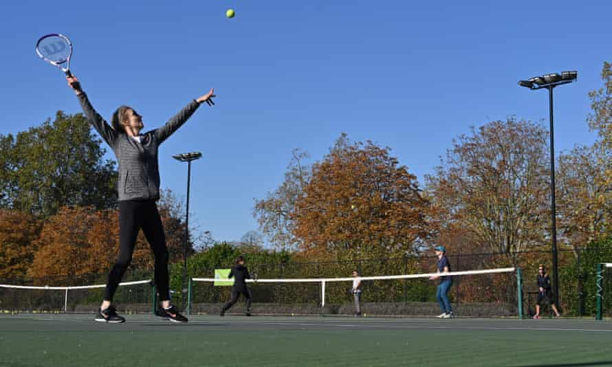 Members of the public play tennis at courts in Hyde Park, London.