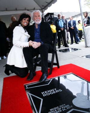 Kenny Rogers with his wife, Wanda Miller, as he is inducted into the Nashville Music City's walk of fame on 24 October 2017 in Nashville, Tennessee