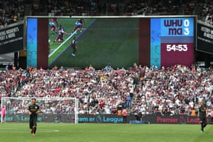 The big screens display why the third Manchester City goal was disallowed by VAR. The goal was ruled out due to Sterling's shoulder being just offside. Manchester City have won their past 15 Premier League games, three short of their own top-flight record (18 between August-December 2017).