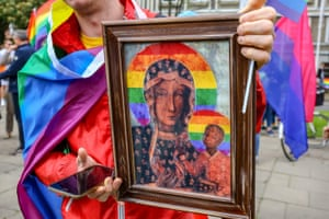 A demonstrator carries a picture of the Virgin Mary at an equality march in 2019 in Gdańsk, Poland. A group of gay rights activists accused of offending religious sentiment after producing and distributing images of the Madonna with a rainbow halo were acquitted of all charges this week.