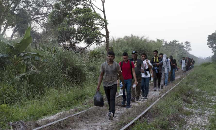 Central American migrants follow train tracks on their journey to the US border.
