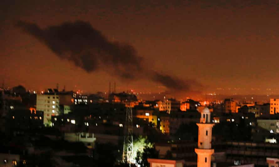 Smoke and flames rise from Gaza City after the Israeli air strikes on 26 December.