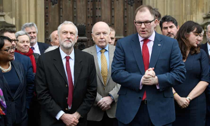 Jeremy Corbyn with the new Labour MP for Stoke Central, Gareth Snell (front right), outside the Houses of Parliament.