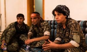 Hevda, right, at the base in Raqqa Samra.