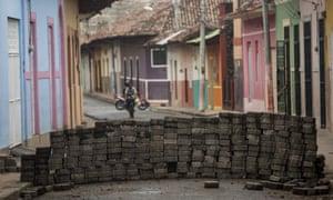 A barricade blocks a street in Granada earlier this week.
