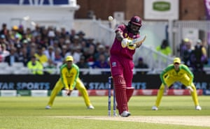 Chris Gayle smashes one to the boundary for four.