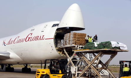 Workers unload a cargo plane carrying humanitarian aid from Saudi Arabia at the Baghdad International Airport in Iraq.