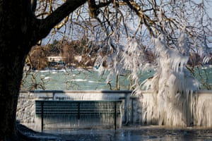 An ice covered bench is pictured at the frozen shore of Lake Geneva, in Geneva, Switzerland, 26 February 2018.