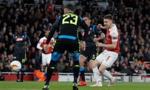 Aaron Ramsey scores Arsenal's first goal against Napoli.