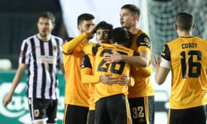 Wolves' Vitinha is congratulated by his team mates after opening the scoring with a fine strike.