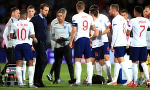 England head coach Gareth Southgate (centre left) speaks to his players before the start of extra time.