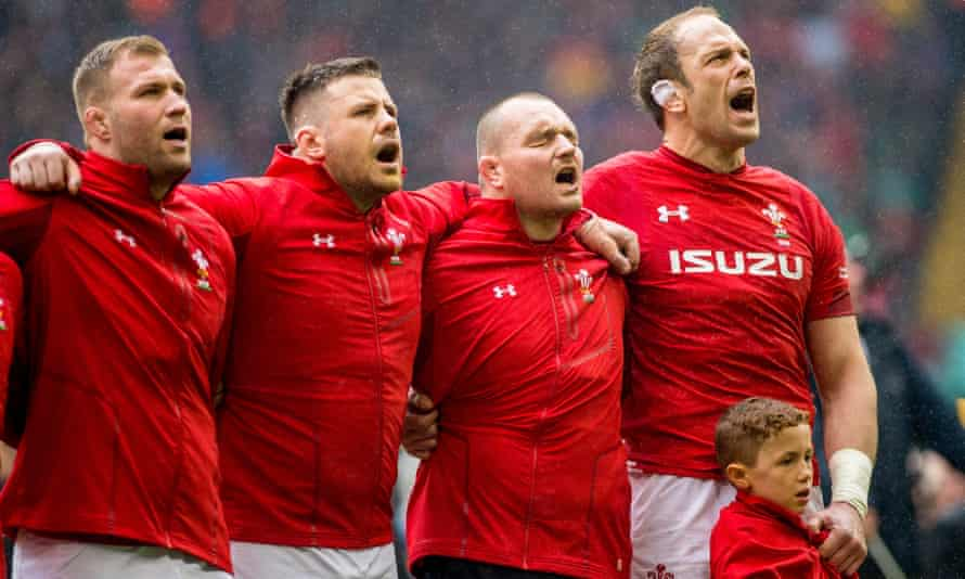 Alun Wyn Jones (far right) in Cardiff before Saturday's grand slam decider, having just given the seven-year-old mascot Joey Hobbs his tracksuit top to protect him from the elements.