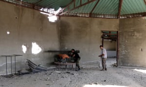 Syrian fighters take their positions during fighting with the regime army in Ghouta, in the Damascus countryside, Syria.