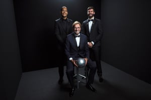 Liverpool manager Jurgen Klopp with players Virgil Van Dijk and Alisson Becker.