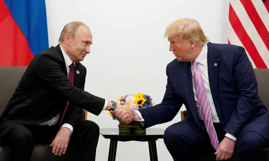 Trump with Putin at the summit in Osaka in June 2019. Grisham says she heard Trump say: 'It's for the cameras, and after they leave, we'll talk. You understand.'