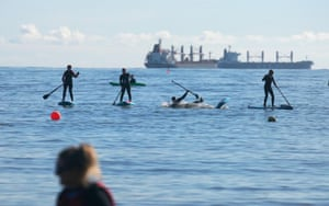 Cullercoats Bay, England. Paddle-boarders train in North Tyneside