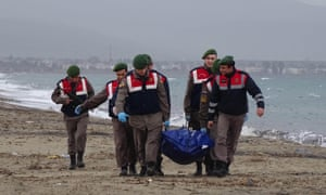 Officers carry the body of a refugee that washed up on the shore in Izmir, Turkey