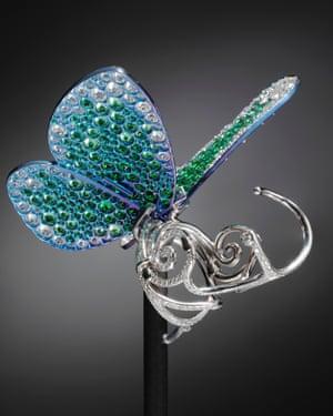 The Papillon has titanium wings encrusted with lush green tsavorites.