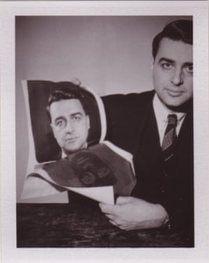 Polaroid inventor and founder Edwin Land carefully separating one of his famous 8x10-inch prints, demonstrating how instant film worked in 1947.