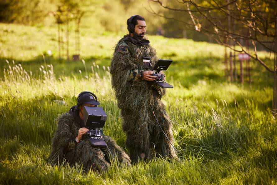 Drone pilot Ibrahim Serra-Mohammed (right) and drone camera operator Tom Elliott from Ascension Films wear full camouflage outfits during the filming of Wolf Alice's set.