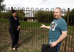 Anthony Bowe (right) shows NSW opposition leader Jodi McKay his mother's room through the fence at Newmarch House on Wednesday.
