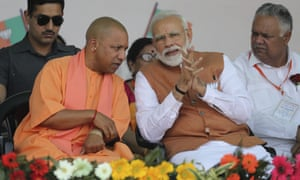 Yogi Adityanath (left), here campaigning with India's PM, Narendra Modi, has received official warning for referring to the armed forces as 'Modi's army'.