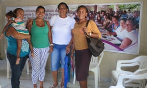 Deyanira Reyes left, Eidanis La Madrid, Paula Castro, and Yajaira Mejía at the offices of the League of Displaced Women in the City of Women, Turbaco.