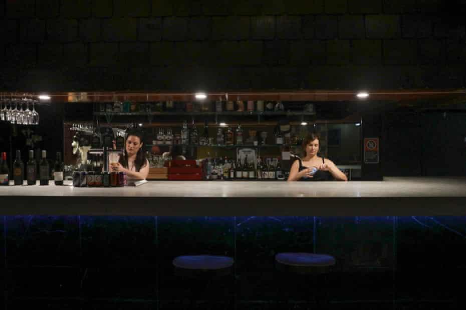 Alison Avron and Brooke Olsen behind the main bar.