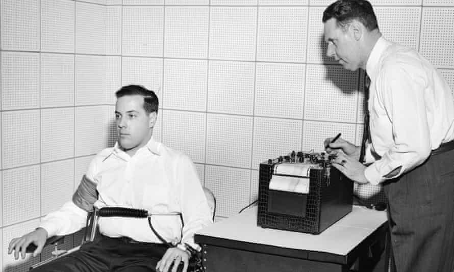 Inventor John Larson, right, demonstrates the operation of a polygraph at Northwestern University,  in Evanston, Illinois, 1930s.