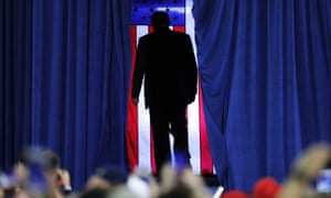 Donald Trump exits after speaking at a campaign rally in Lake Charles, Louisiana on Friday.