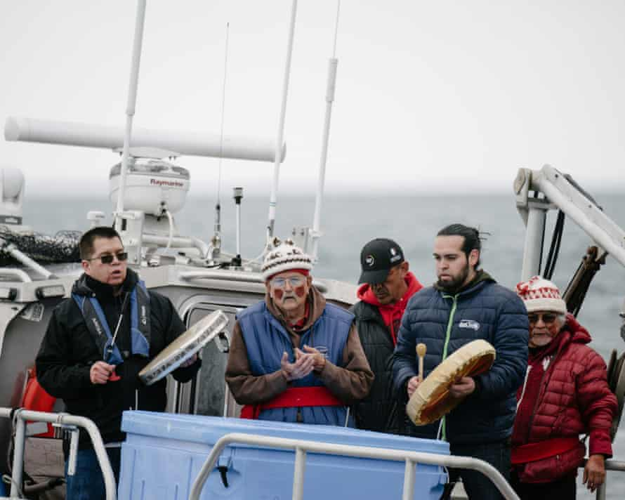 Lawrence Solomon, Secretary of the Lummi Business Council, Bill James, hereditary chief, Jeremiah Julius, Lummi Tribal Chairman, Tony Hillaire, Chief of Staff of the Lummi Nation Business Council and tribal leader Al Johnnie finish the ceremonial feeding of a live, chinook salmon on the waters off Henry Island, Wednesday, April 10, 2019 in Washington.