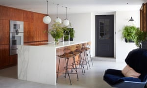 'Everything has been designed to face outwards, so we can cook and chat': the kitchen.