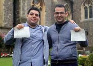 Sulaiman Wihba and Elias Badin, who are Syrian refugees, pose with their results at Brighton college